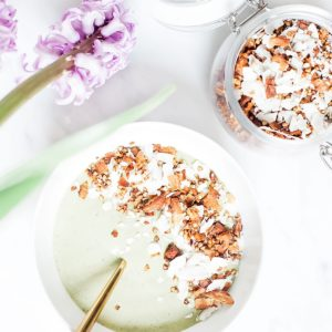 Pistachio ice cream smoothie bowl with coconut buckwheat granola from above.