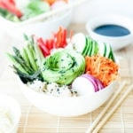 Sushi salad in bowl from the side with avocado rose.