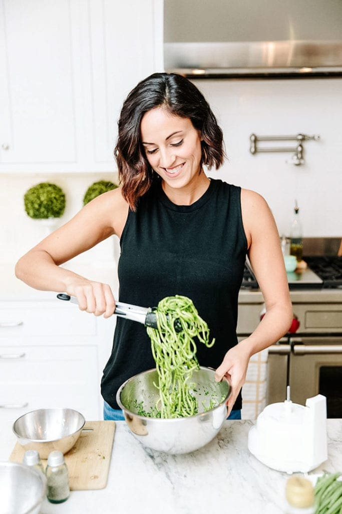 Ali from the blog Inspiralized tossing zucchini noodles.
