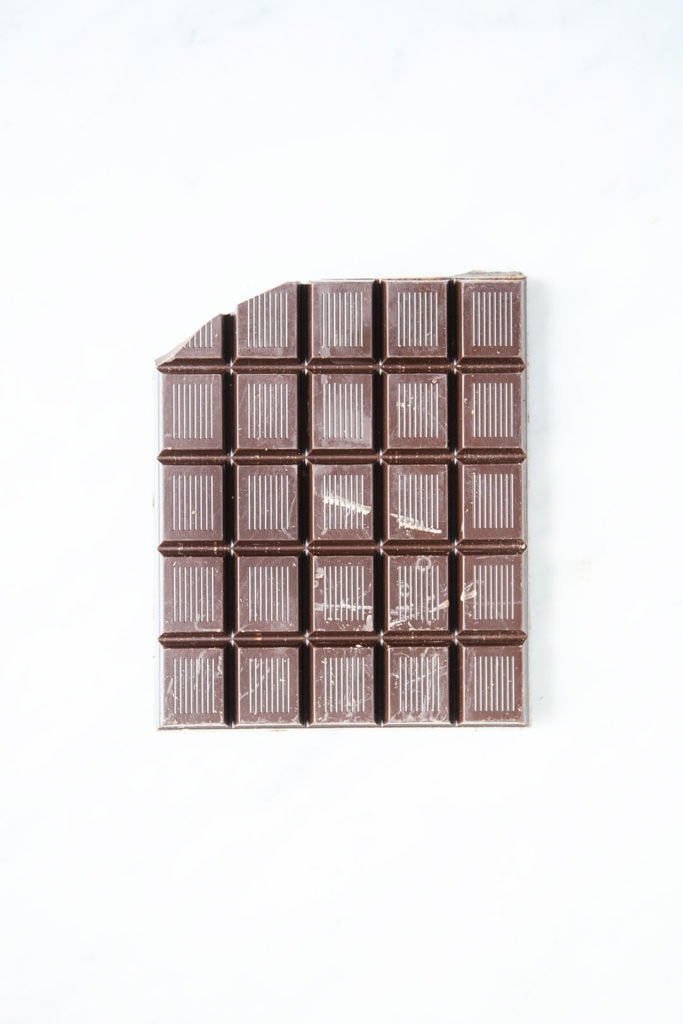 Dark chocolate bar on white background.