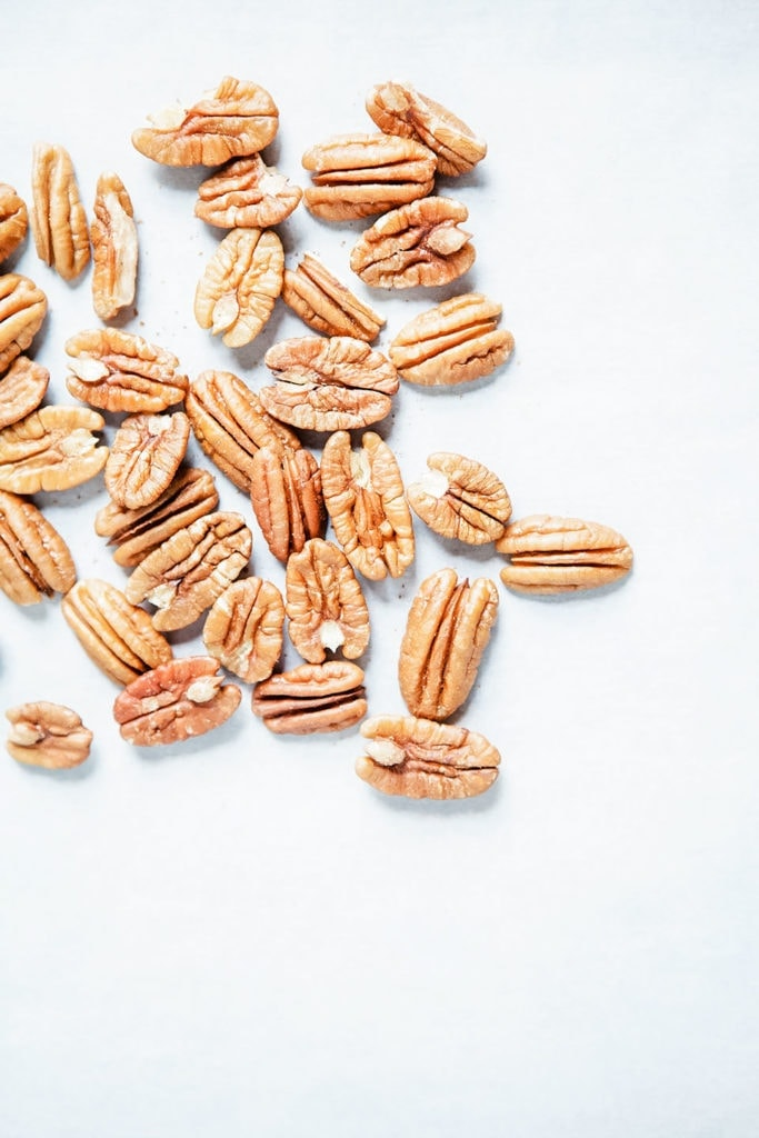 Pecans on a white background.