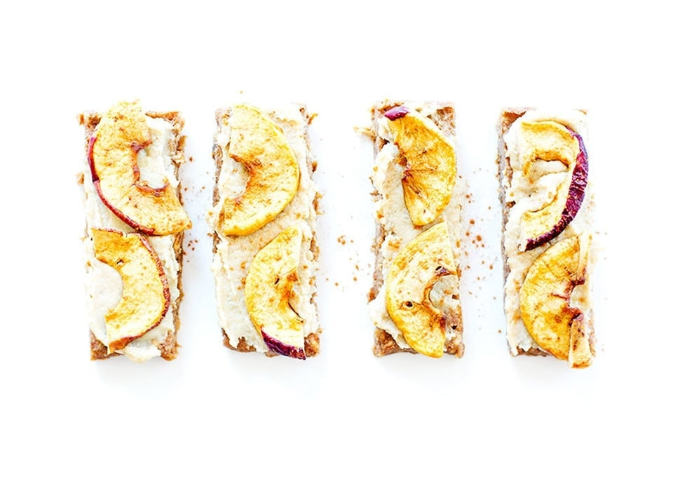 Four apple pie bars on a white background.