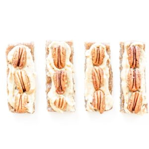 Pecan pie bars on a white background.