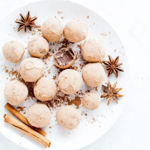 Five-spice chocolate truffles on a white plate.