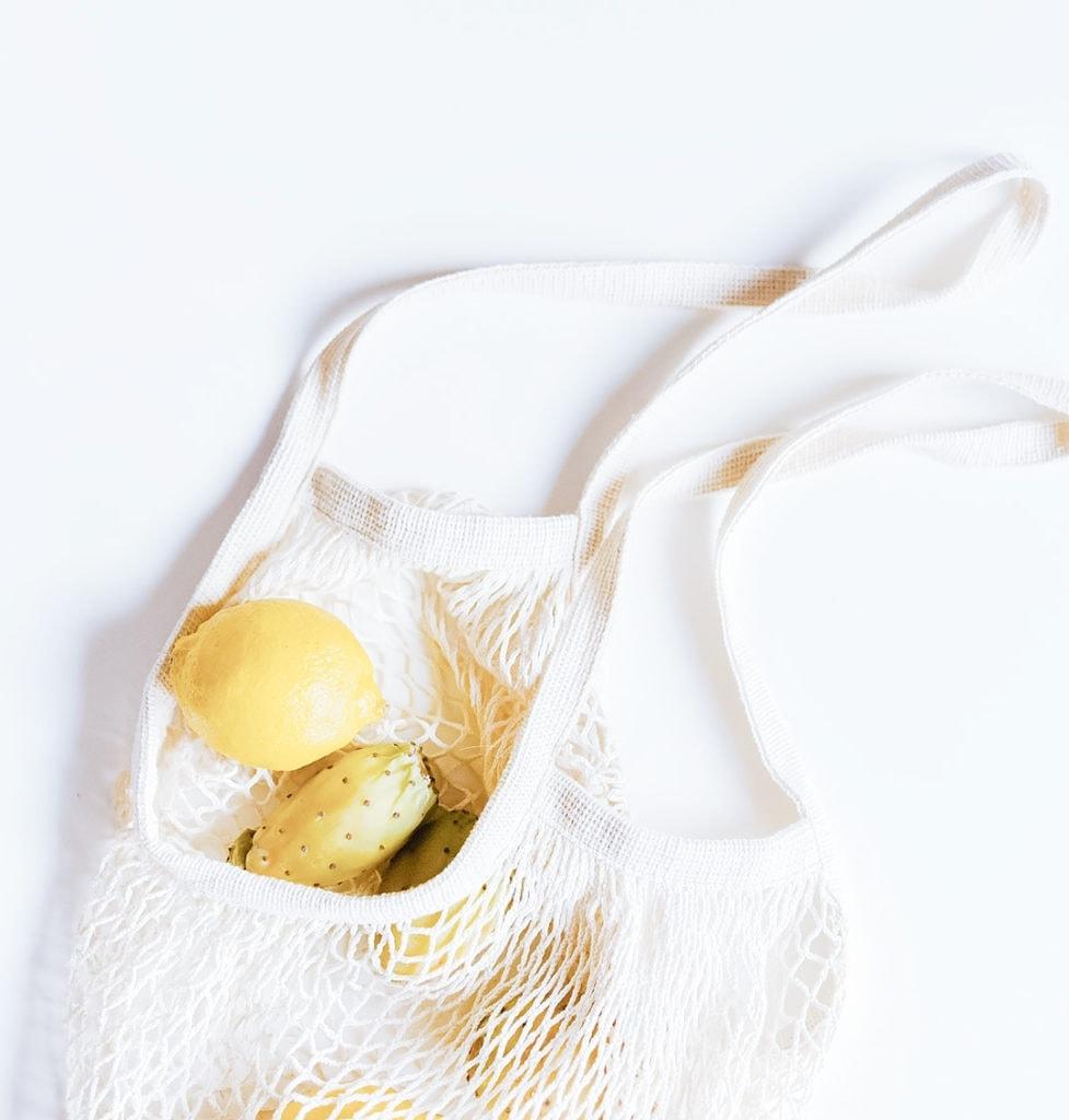 Lemons in a mesh tote.