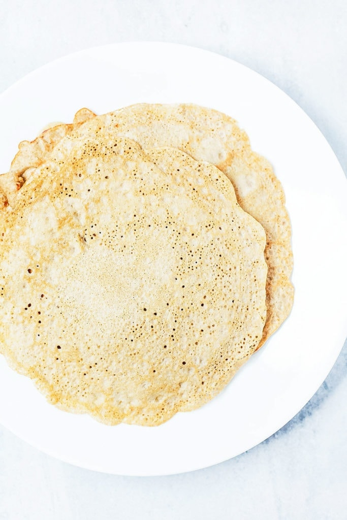 Gluten-free oat crepes on a white plate.