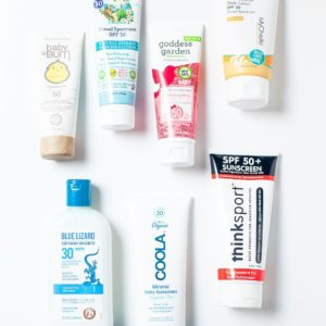 Tubes of non-toxic sunscreen on a white background.