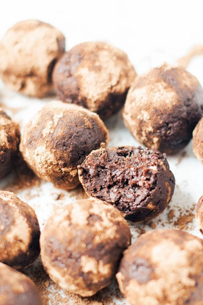 Vegan seed cycling brownie bites with one bite taken out of one.