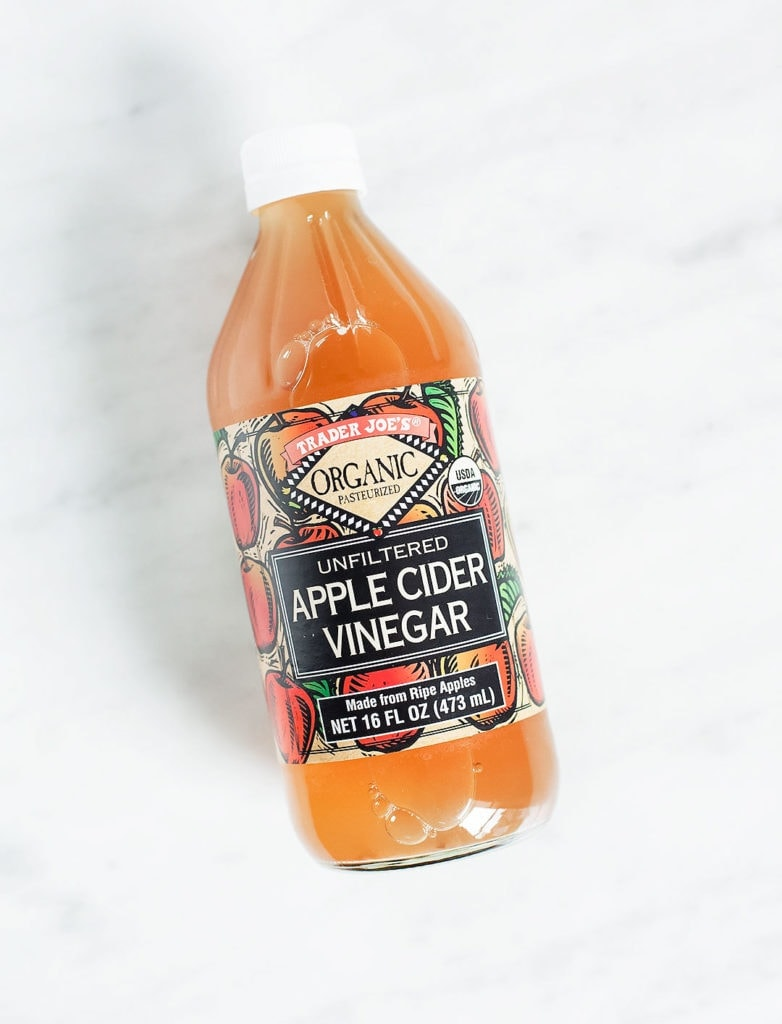 Trader Joe's apple cider vinegar on a white background.