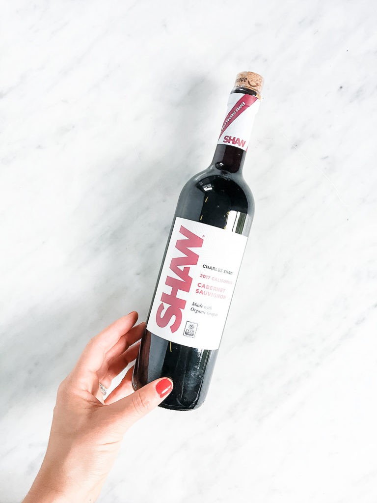 Trader Joe's organic Shaw red wine on a white background.