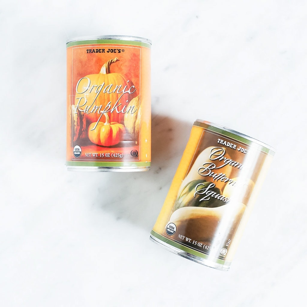 Trader Joe's canned pumpkin and canned butternut squash on a white background.