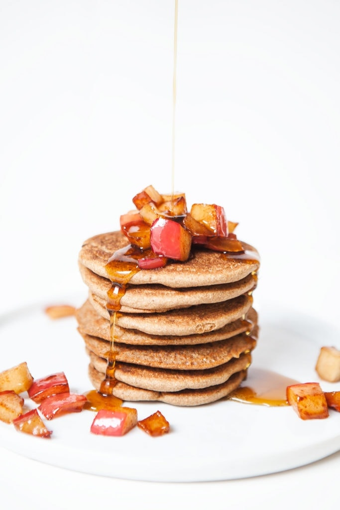 Stack of gluten-free apple cinnamon pancakes with apple topping.