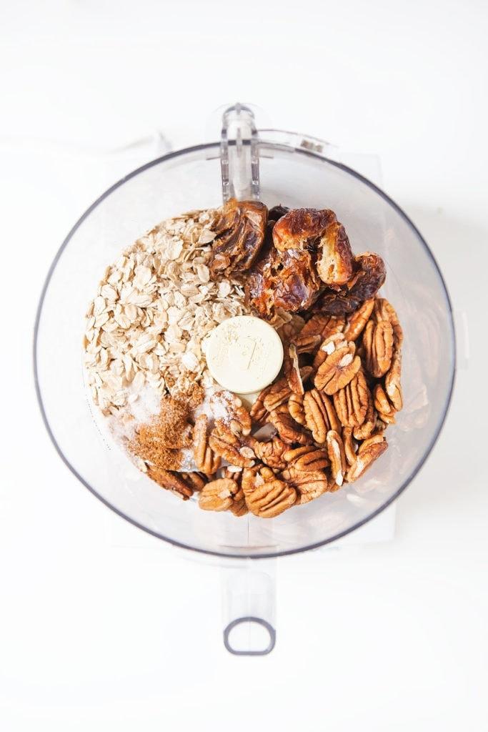 Healthy pumpkin pie ingredients in a food processor.