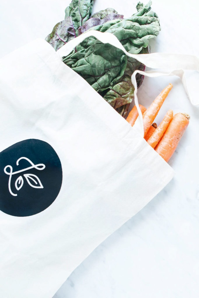 Loveleaf Co. tote with greens and carrots inside.