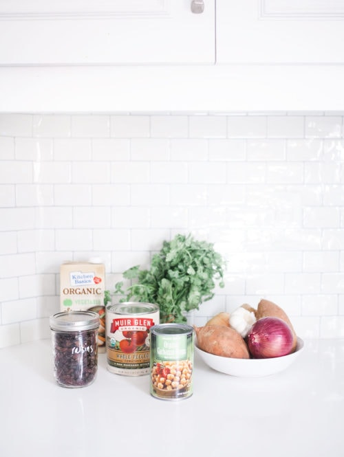 Ingredients on a white kitchen counter with white subway tile in the background.