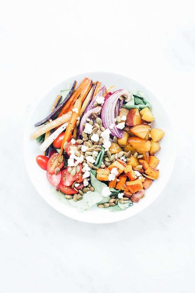 Rainbow harissa bowls in a white bowl on a white background.