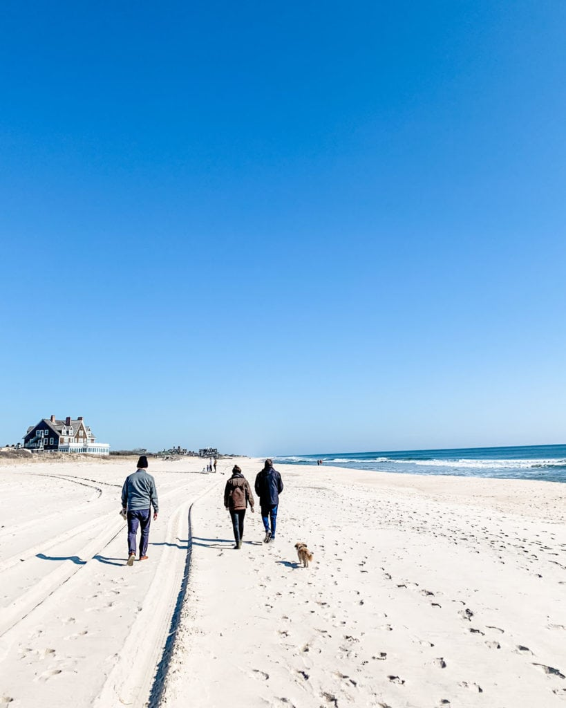 Family walking on the beach in Southampton, New York.