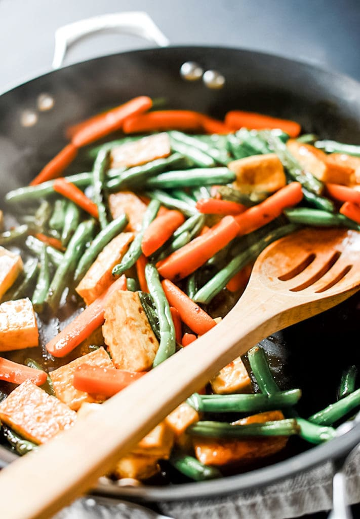Veggie tofu stir-fry in a cast-iron skillet.