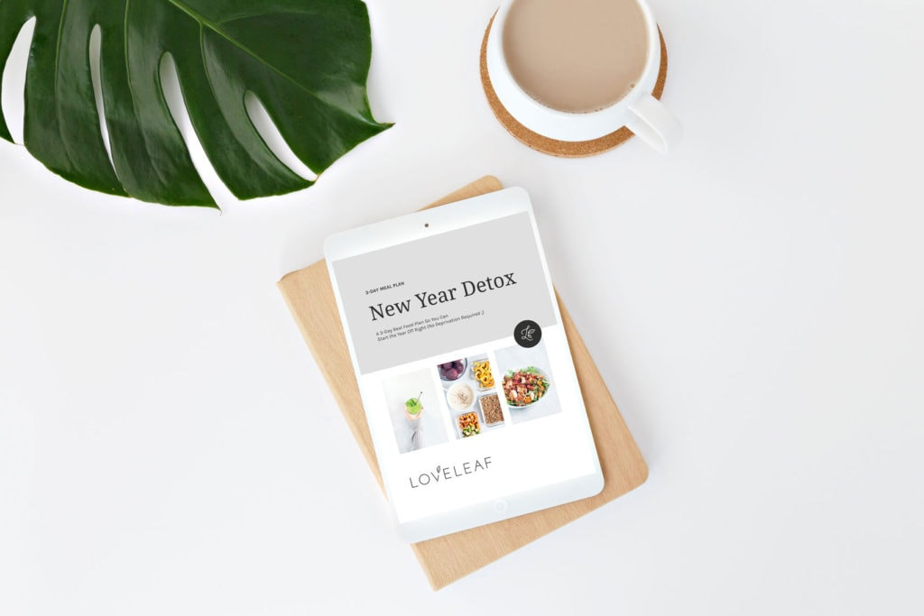 Loveleaf Co. New Year Detox on a white iPad on a desk with a cup of coffee.