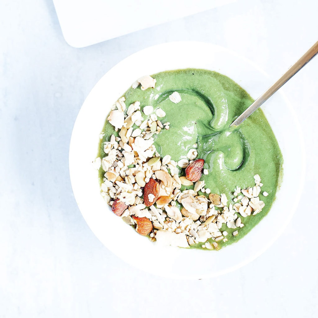 Green smoothie bowl in a white bowl.