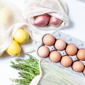 Lemons, onions, asparagus, and eggs on a white background,