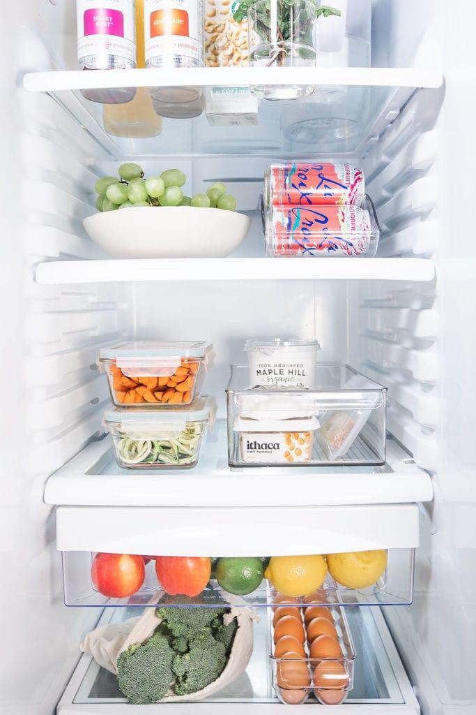 Stocked and organized refrigerator.
