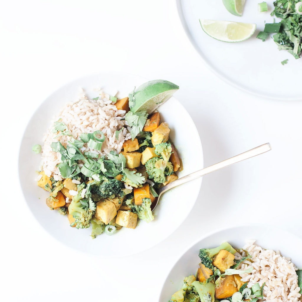 Broccoli and sweet potato curry in white bowls.