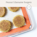 Peanut edamame burgers wrapped in lettuce on a baking sheet from above.